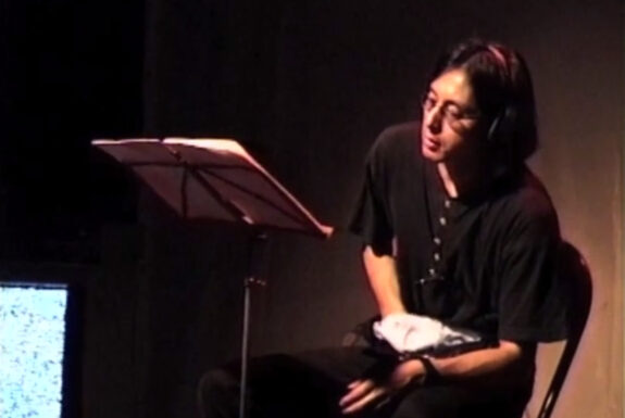 Yuji Sone performs The Voice of the Masked Other, 7a*11d 1997