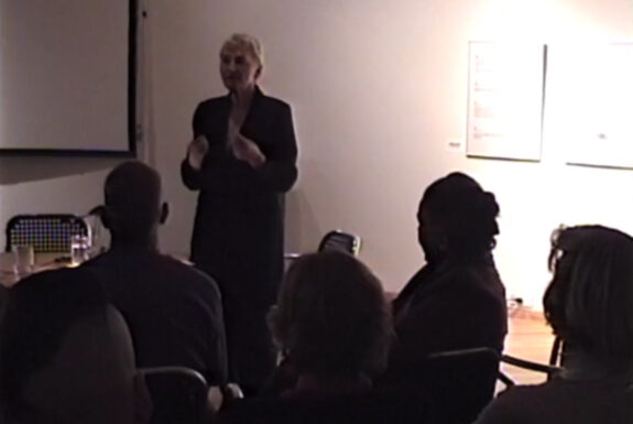 """Slavka Sverakova delivering her lecture """"Performance Art in Ireland, 1975-1998"""" at Some Assembly Required, 7a*11d 1998"""
