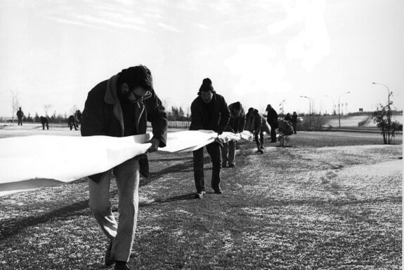Glenn Lewis performing 400 Yards of Burned Paper in a Square with studetns in Calgary in 1969