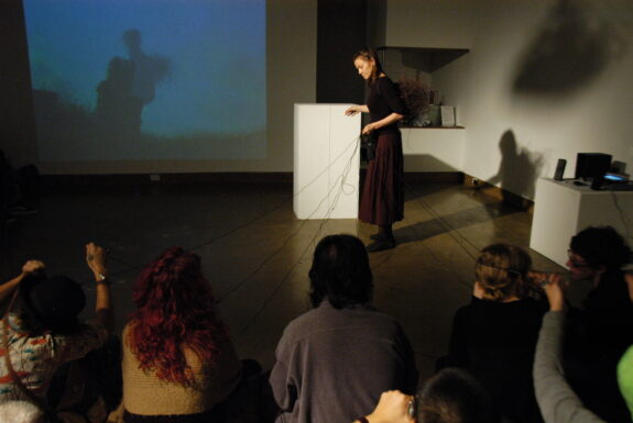 Annette Arlander performing Wind Nest – variation at XPACE Cultural Centre