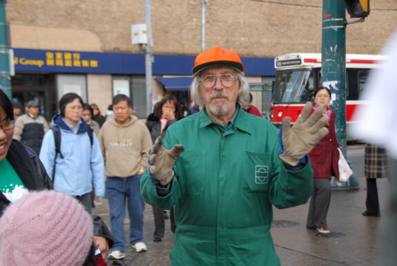 Glenn Lewis performing A Sweeping Statement Friday along an off-site route: Shaw St, Dundas St W, Spadina Ave, Queen St W