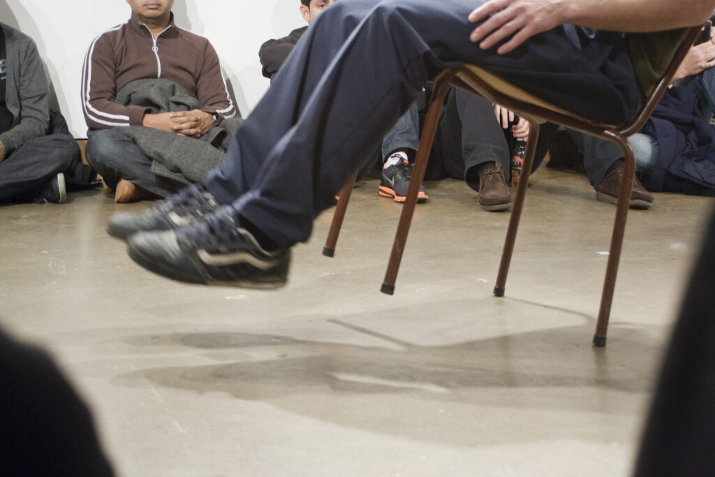"""Étienne Boulanger performing Trajectory for a paradoxical escape or """"The chair's walk"""" at XPACE Cultural Centre"""