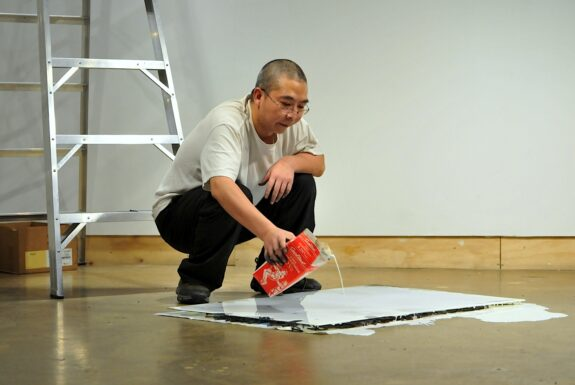 Chen Jin performing 'Point at the world' at XPACE.