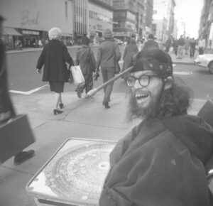 Frank Moore panhandling in front of Altman's department store, New York, USA early 1970s PHOTO unknown