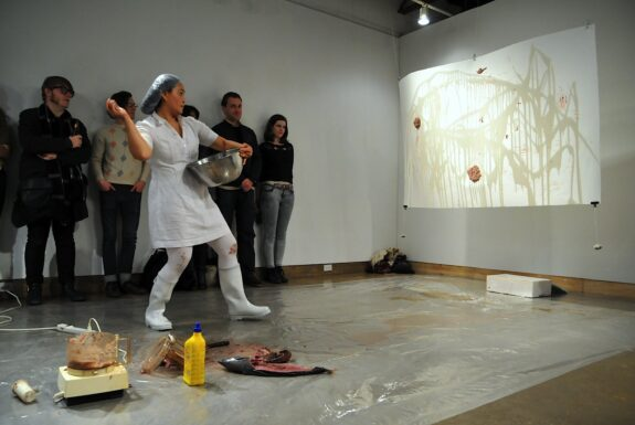 Chuyia Chia performing Who is the predator and prey? at XPACE Cultural Centre