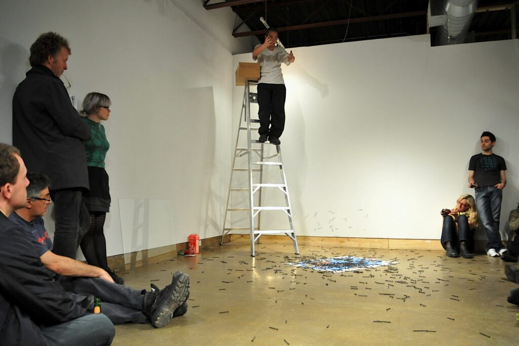 Chen Jin performing Point at the World at XPACE Cultural Centre