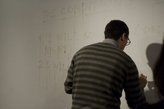 Julian Higuerey Núñez performng the conditions of surrender at XPACE Cultural Centre