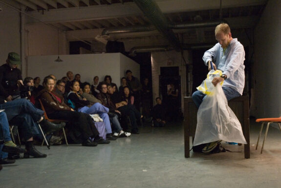 Ed Johnson performing Inquisitive/Inquisitor at XPACE Cultural Centre