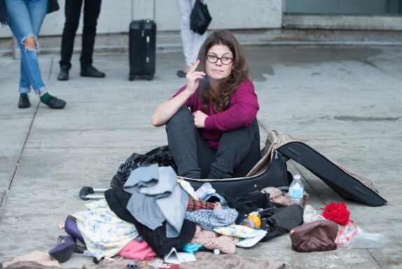 Tanja Ostojić performing Misplaced Women? at the corner of Dundas St W & McCaul